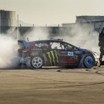 Ken Block doing donuts between two cops on Segways while filming Gymkhana 6.